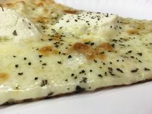 White Pizza Slice on Paper Plate in Manhattan, New York, NY. White Pizza Slice on Paper Plate in New York, NY stock image