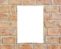 White placard taped on the wall. White placard taped on the brick wall Stock Photos