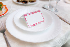 White place card decorated on a plate Stock Image