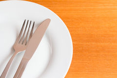 White place setting on wooden table Stock Photo