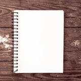 white plain notebook for social media marketing post with wooden background stock photo