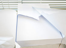White plain office paper in A4 size. White plain office paper beside window background, blank paper stock photos