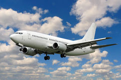 White plane landing. A white plane landing against colorful sky Stock Photo