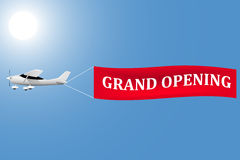 White plane with a banner grand opening in the sky. Vector illustration Royalty Free Stock Photo