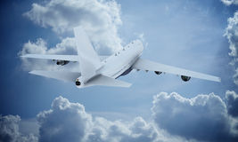 White plane flying in sky and clouds. Airplane boeing 747 Stock Images