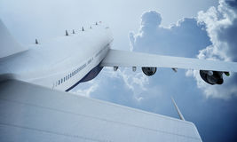 White plane flying in sky and clouds. Airplane boeing 747 Stock Photography