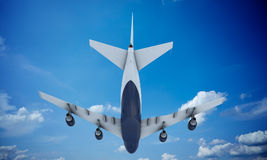 White plane flying in sky and clouds. Airplane boeing 747 Royalty Free Stock Photos