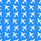 White plane icons on blue background seamless Royalty Free Stock Photos