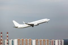 White plane takes off from the runway Stock Photos