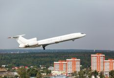 White plane takes off from the runway Royalty Free Stock Image