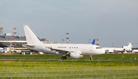 White plane takes off from the runway Stock Images