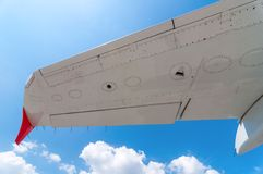 White plane wing on a blue sky background. Travel Stock Images