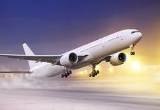White plane in winter blizzard stock image
