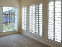White Plantation Style Wood Shutters Royalty Free Stock Photography