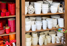 White planters in the florist shop. New white clay pots in the florist shop stock photography