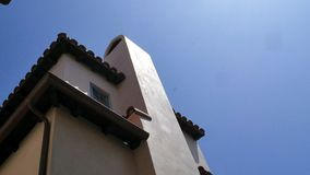 White Plaster Building with Spanish Tile Roof with Blue skies and Chimney stock photography