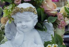 White plaster sculpture of an angel with wings in the interior royalty free stock photo