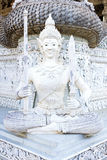 A white plaster statue in Ming Muang temple, Nan province, Thail Stock Photo