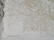 White plastered wall with cracks Royalty Free Stock Photos
