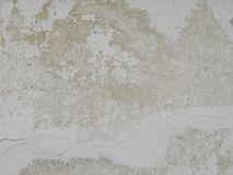 White plastered wall with cracks Stock Photo