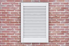 White Plastic Air Ventilation Grille Window. 3d Rendering. White Plastic Air Ventilation Grille Window on a brick wall. 3d Rendering stock illustration