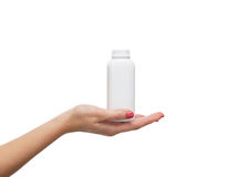 A white plastic bottle held in a hand of a young woman Royalty Free Stock Photos