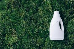 Free White Plastic Bottle Of Cleaning Product, Household Chemicals Or Liquid Laundry Detergent On Green Grass, Moss Royalty Free Stock Image - 213634906