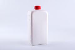 White plastic bottle on a white background Royalty Free Stock Image