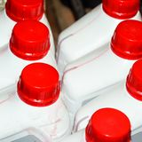 White plastic cans with red lids royalty free stock image