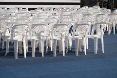 White plastic chair. Arranged in rows Stock Photos