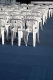 White plastic chair. Lined up Royalty Free Stock Photo