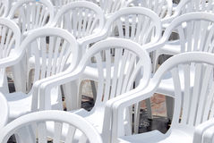 White plastic chairs Stock Photos