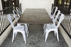 White plastic chairs on brick block ground at restaurant terrace Royalty Free Stock Photo