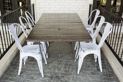 White plastic chairs on brick block ground at restaurant terrace Stock Photography