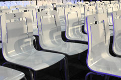 White plastic chairs in diagonal Royalty Free Stock Photos