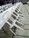 Plastic chairs resting on the tables Royalty Free Stock Photography