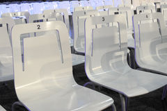 White plastic chairs with numbers Stock Photo