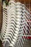 White plastic chairs overlap in vertical. Close view Royalty Free Stock Photos