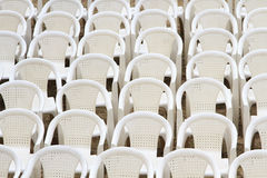 White plastic chairs put up for conference Royalty Free Stock Images