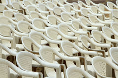 White plastic chairs put up for conference Royalty Free Stock Photo