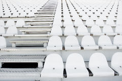 White plastic chairs in rows Royalty Free Stock Photos