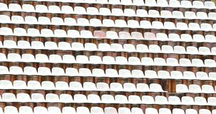 White plastic chairs in the stadium of football Stock Image
