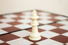 Chesspiece king on the board stock photography