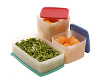 White plastic containers with many-coloured covers Royalty Free Stock Photos