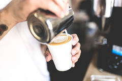 White Plastic Cup With Cappuccino Topped With Cream Royalty Free Stock Photos