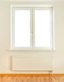 White plastic double window and radiator Royalty Free Stock Photography