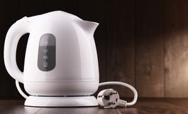 White plastic electric kettle on the table.  royalty free stock photography