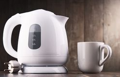 White plastic electric kettle on the table.  royalty free stock photos