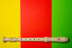 White plastic flute. On colored background Royalty Free Stock Image
