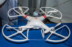 White plastic flying drone with four propellers company DJI Stock Photos